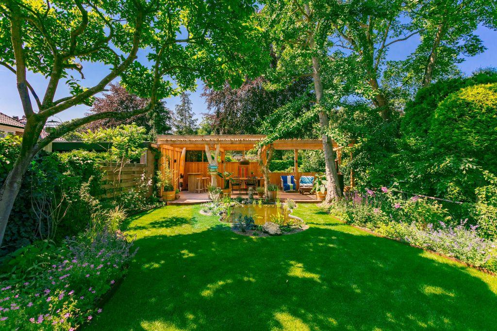 Renovatie en aanleg landelijke tuin met overkapping